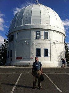 President Mike Bradley in front of the Plaskett Telescope at the DAO in Victoria
