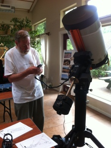 Michael Bradley with the observatory telescope