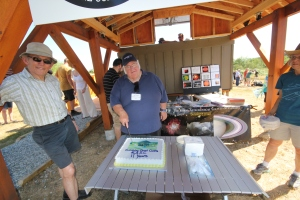 Bill Clark cuts the cake