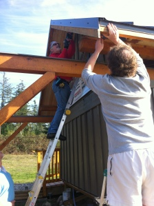 Charles and Scott installing the soffit on the N side
